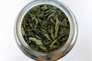 Close up on the Jar Full of Dry Mint Tea Leaves