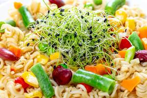 Close - up pasta with vegetables and micro onion greens (Flip 2019)