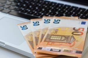 Close Up Photo of 50 Euro Banknotes on a Laptop