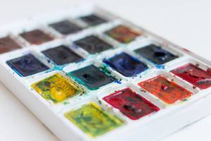 Close Up Photo of Colorful Water Color Paint Tray for Artists on White Background
