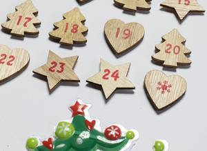 Close Up Photo of DIY Wooden Advent Calendar on a Wall