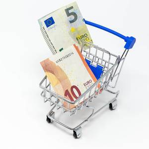 Close Up Photo of Euro Banknotes in a Supermarket Cart on White Background