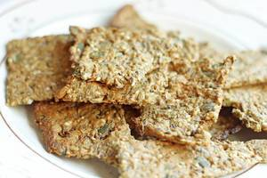 Close Up Photo of Homemade Crackers on a white Plate