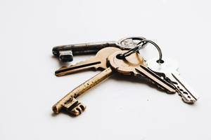 Close Up Photo of Old Vintage Keys on White Background