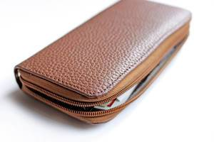 Close Up Photo of Opened Brown Purse on White Background