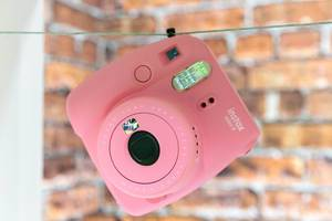Close Up Photo of Pink Fujifilm Instax Mini 9 hanging on a Rope