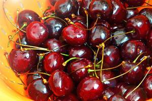 Close Up Photo of Washed Cherries in a Bowl