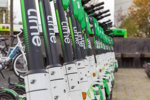 Close-up photo with the brand name: the popular electric scooters operated by Lime provide the citizens of Cologne with a smart urban mobility solution