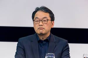 Close-up portrait of Dr. Alex Jinsung Choi, SVP of Strategy and Technology Innovation (STI) of Deutsche Telekom, on the Digital X stage in Cologne