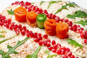 Close-up salad decorated with pomegranate seeds, arugula, carrot and cucumber (Flip 2020)