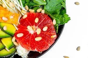 Close-up salad with grapefruit, avocado, micro greenery and pine nuts (Flip 2020)