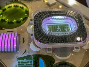 Close-up shot of a model of Al Rayyan Stadium