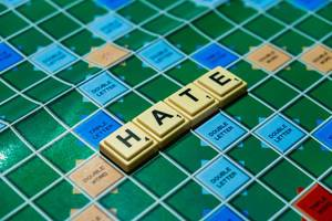 "Close up shot of ""Hate"" word on scrabble board"