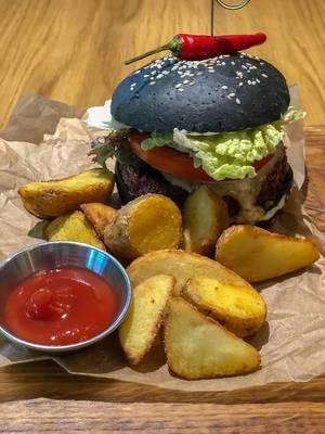 Close-up shot of Veg Kuro burger at Avocado Cafe