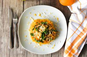 Close Up Top View Food Photo of Lemon and Basil Spaghetti Squash on Wooden Table