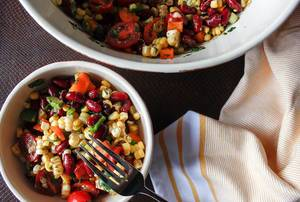 Close Up Top View Food Photo of Mexican Salad with Corn, Beans, Cherry Tomatoes and Beans