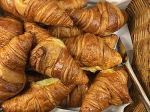 Close Up Top View Photo of Croissants in a Basket