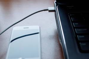 Close-up usb cable connect phone and laptop computer