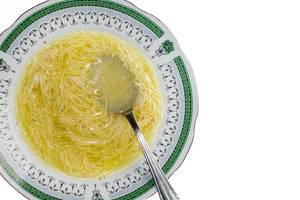 Closeup image of homemade chicken soup with noodles