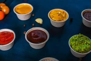 Closeup of appetizer sauces. Ketchup. (Flip 2019)
