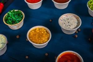 Closeup of appetizer sauces. Pumpkin and mango sauce (Flip 2019)