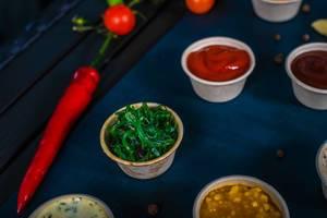 Closeup of appetizer sauces. spinach sauce (Flip 2019)