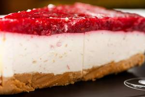 Closeup of Cheesecake with Raspberry cream