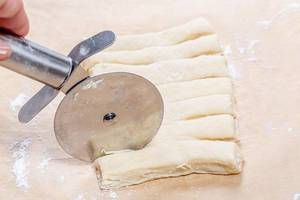 Closeup of cutting the dough for the buns