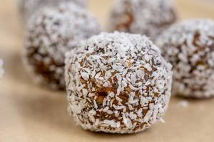 Closeup of Dates and Peanut Butter energy balls in the Coconut