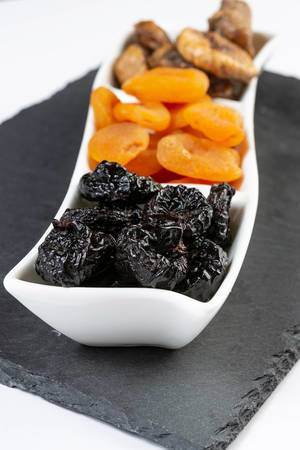 Closeup of Dried Plums Peaches and Figs
