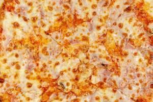 Closeup of Fresh Pizza with Ham and Mushrooms (Flip 2019)