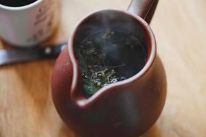Closeup Of Hot Tea In Ceramic Teapot