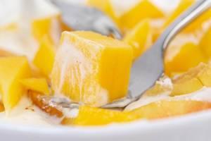 Closeup of Peaches and Mango in the Greek Yogurt (Flip 2019)