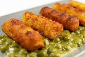 Closeup of Potato Croquettes with Cooked Green Peas