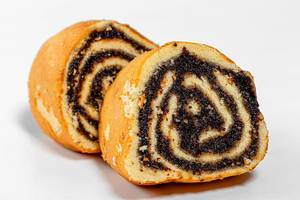 Closeup of slices of biscuit roll with poppy seed filling (Flip 2019)