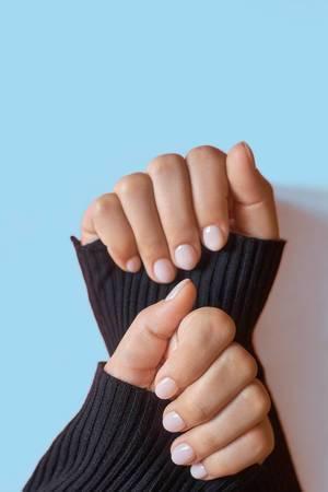 Closeup photo of a beautiful female hands with elegant manicure.jpg