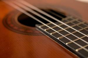 closeup shot of guitar and strings
