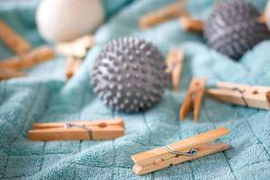 Clothes pins and spiky massage balls on a bath towel