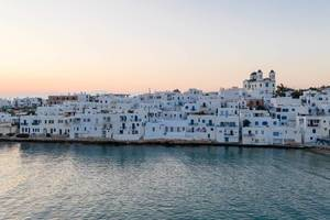 Coast of the picturesque port city Naoussa in the Mediterranean Sea, on Cycladic island Paros, Greece