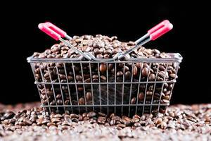 Coffee beans in a shopping basket, black background (Flip 2019)