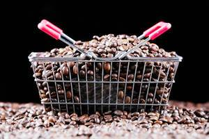 Coffee beans in a shopping basket, black background