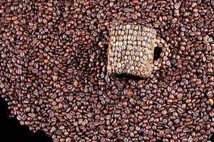Coffee beans mug on coffee beans background (Flip 2019)