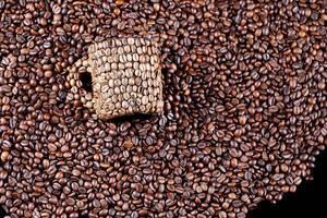 Coffee beans mug on coffee beans background
