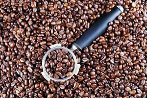 Coffee maker sump, coffee beans background