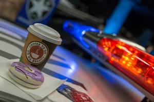 Coffee to go und Donuts