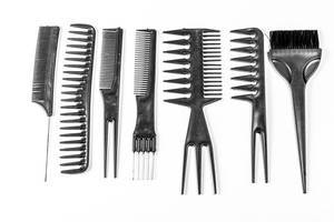 Collection of black combs on white background. Top view (Flip 2020)