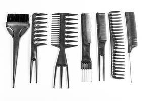 Collection of black combs on white background. Top view