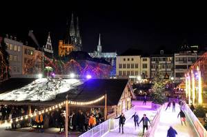 Cologne Christmas Market with Ice Skating and Curling with Cologne Cathedral in the Background