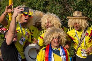 Colombian soccer fans with blonde wigs