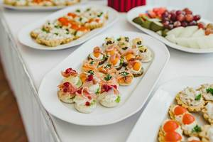 Colorful Appetizers On The White Plates